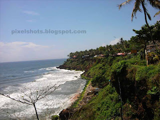 kerala beaches bordered by hills,unique beach landscape with mountain cliffs facing the sea,varkala mountain cliffs and beach