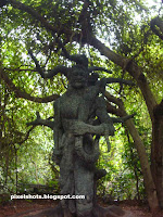 vikramaditya and vethala sculpture of leisure park thenmala,big sculpture inside forest with trees around,huge mythical character sculptures,sculpture garden photos,tree big sculptures