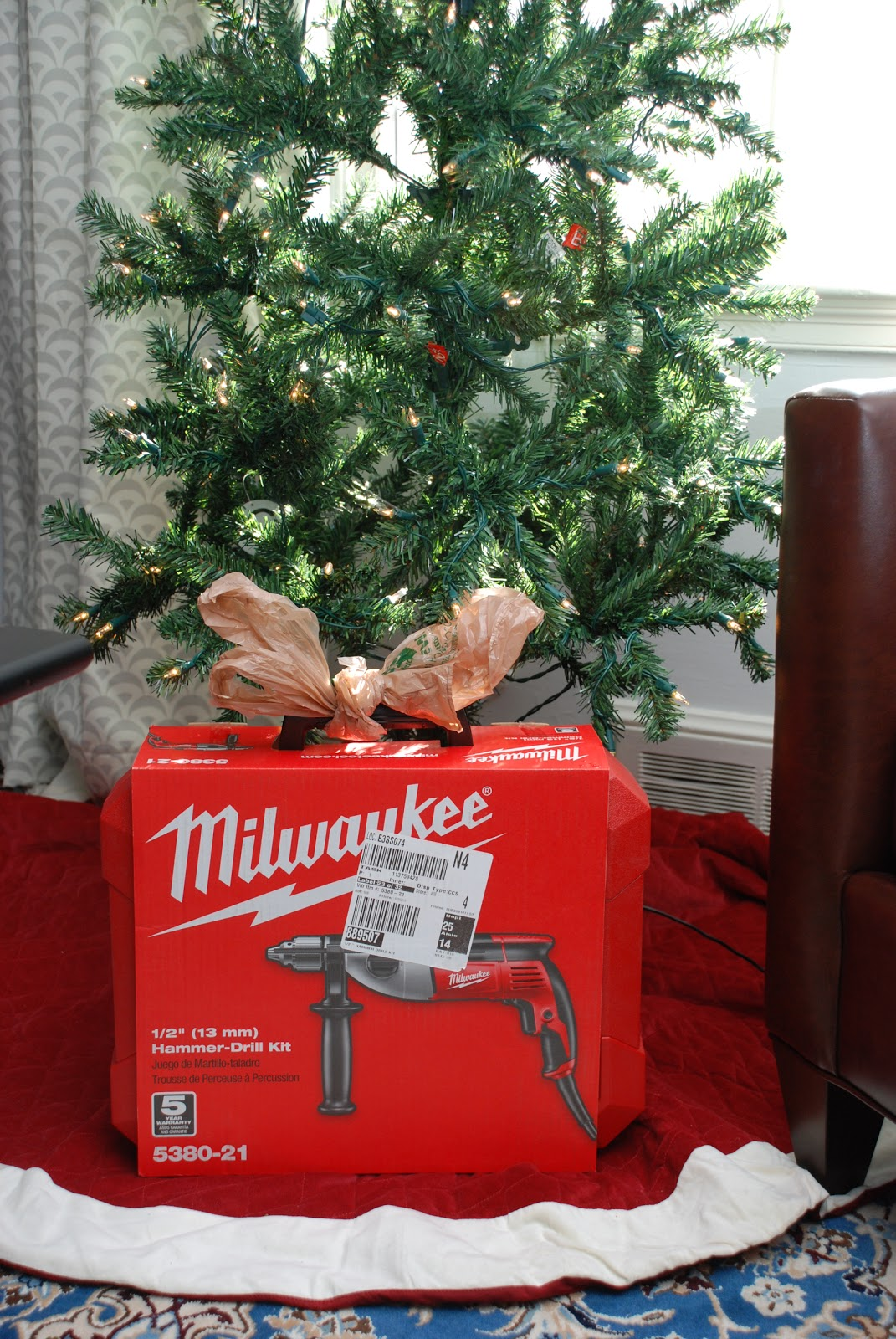 Our little beehive becoming handy through home renovation cooking - A Milwaukee 1 2 Hammer Drill Complete With A Bow Fashioned From A Home Depot Shopping Bag