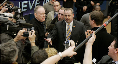 A Secret Service agent, center, intervened after Bill O'Reilly, of Fox News, shoved Marvin Nicholson, the national trip director for the Obama campaign. (Photo: Jim Bourg/Reuters)