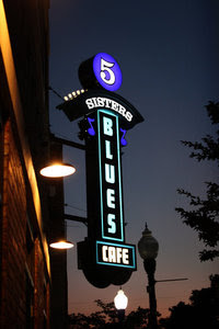 Five Sisters Blues Cafe sign at night