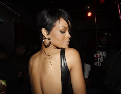 star tattoos down the back. Here you see Rihanna's star necked tattoo that goes down her back