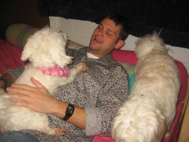 Tim with Chloe on him and Dakota by his side (our crazy dogs).