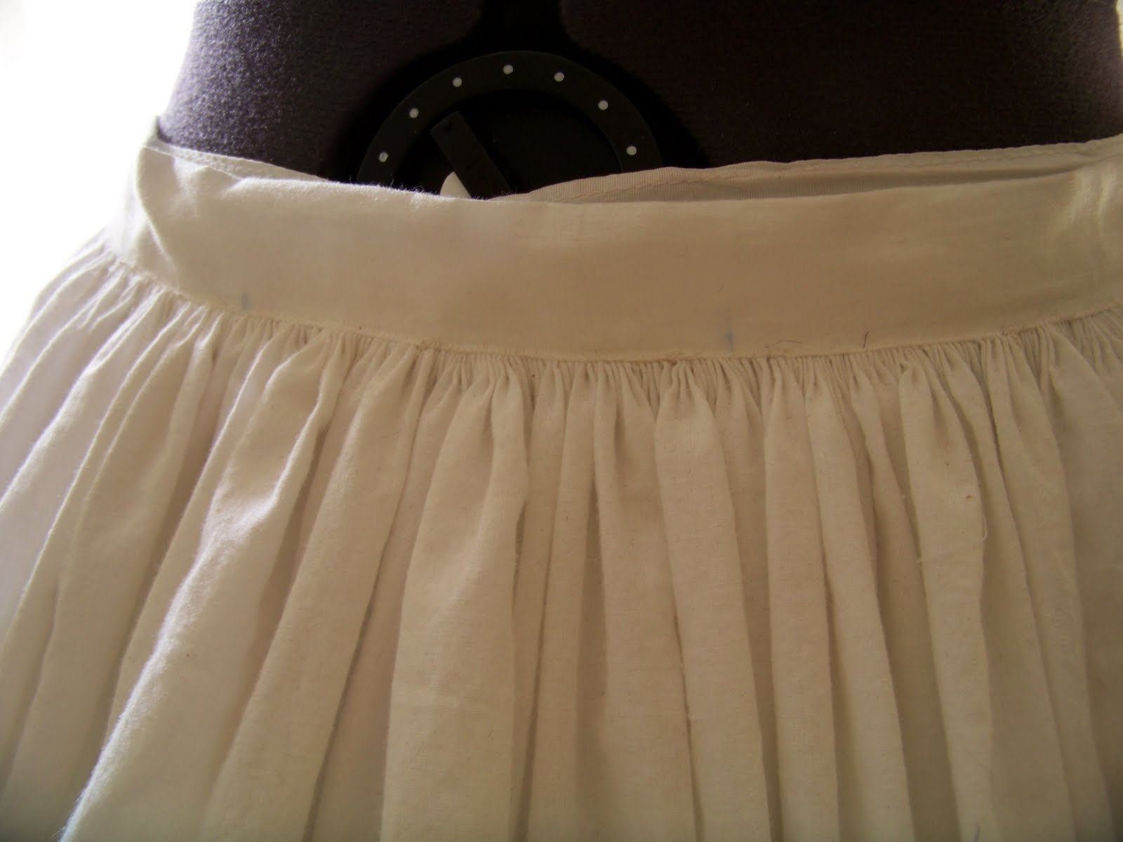 mid-century dress project, I recently hand-sewed a muslin petticoat