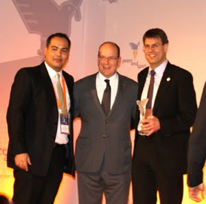 Leandro Olvech (left), Prince Albert and Thomas Weikert during the award ceremony in Monaco.