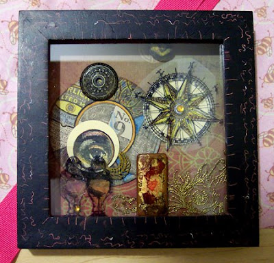 Shadow box with stamped transparency.