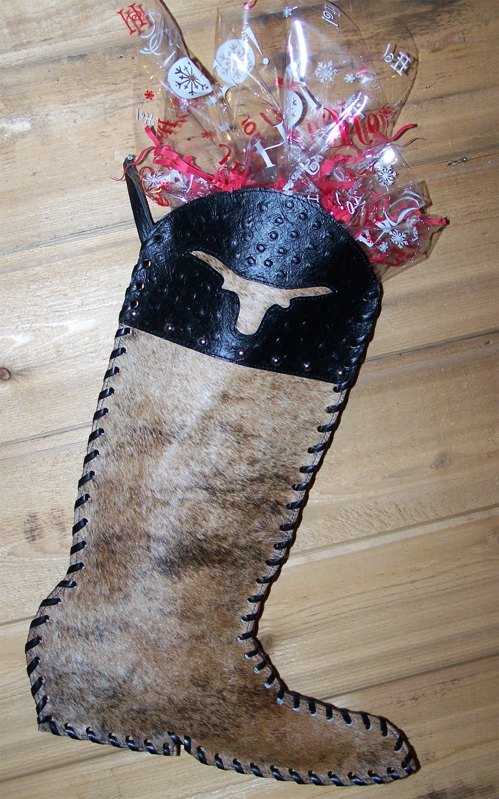 Western Christmas Stocking Patterns http://hmvalleyranch-wwwbloggercom.blogspot.com/2010/10/cowhide-christmas-stocking.html