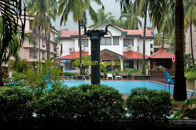 The view around the swimming pool of the Palmarinha Resort in Goa