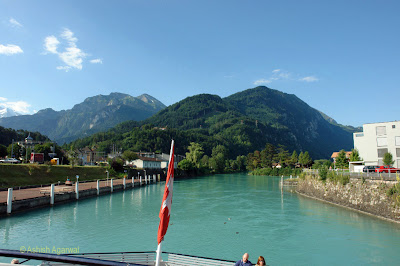 Ship moving in reverse while moving out of the canal connecting Interlaken to Lake Thun