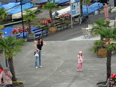 Mom and kids waiting to board the cruise ship on Lake Thun
