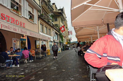 The cobble-stone path along the lakefront with open air cafes in Lucerne