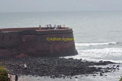 People at ruins of the fort near the Taj resort near Aguada Goa