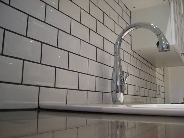Subway with Accent Backsplash white subway tile backsplash behind sink