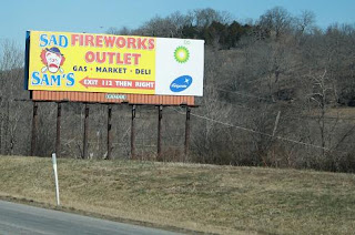 Road Sign: Sad Sam's Firework Outlet
