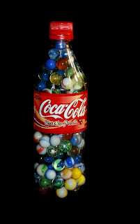 Plastic Coca Cola Bottle Filled with Marbles