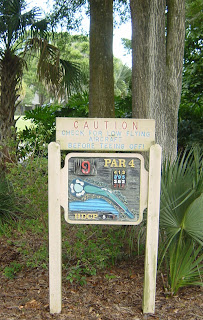 CAUTION check for Low flying aircraft. Sign on hole 9 at the Spruce Creek Country Club