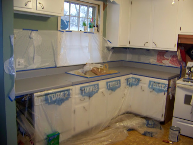 ... walls, cabinets, and sinks that would be exposed to the spray paint