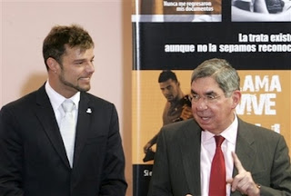 Puerto Rico's pop star Ricky Martin, left, speaks with Costa Rica's President Oscar Arias, right, during a ceremony to launch the project called 'Llame y Vive' , Call and Live, against human trafficking and slavery being launched in Costa Rica and Latin America at the Presidential House in San Jose, Tuesday, Feb. 20, 2007. (AP Photo/Kent Gilbert)