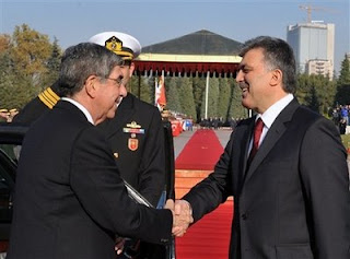 In this picture released by the Turkish Presidency Press Service, Turkish President Abdullah Gul, right, welcomes Costa Rica President Oscar Arias before during a ceremony at the presidential palace in Ankara, Turkey, Wednesday, Nov. 25, 2009. ( AP PhotoMustafa Oztartan, Turkish Presidency Press Office)