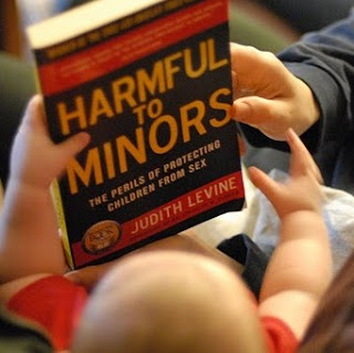 Little Foot pulls books off the shelves: this one is titled Harmful to Minors: The Perils of Protecting Children from Sex