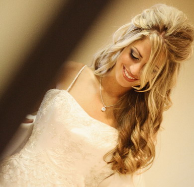 Romantic wedding hair styles include loose chignons, half updos