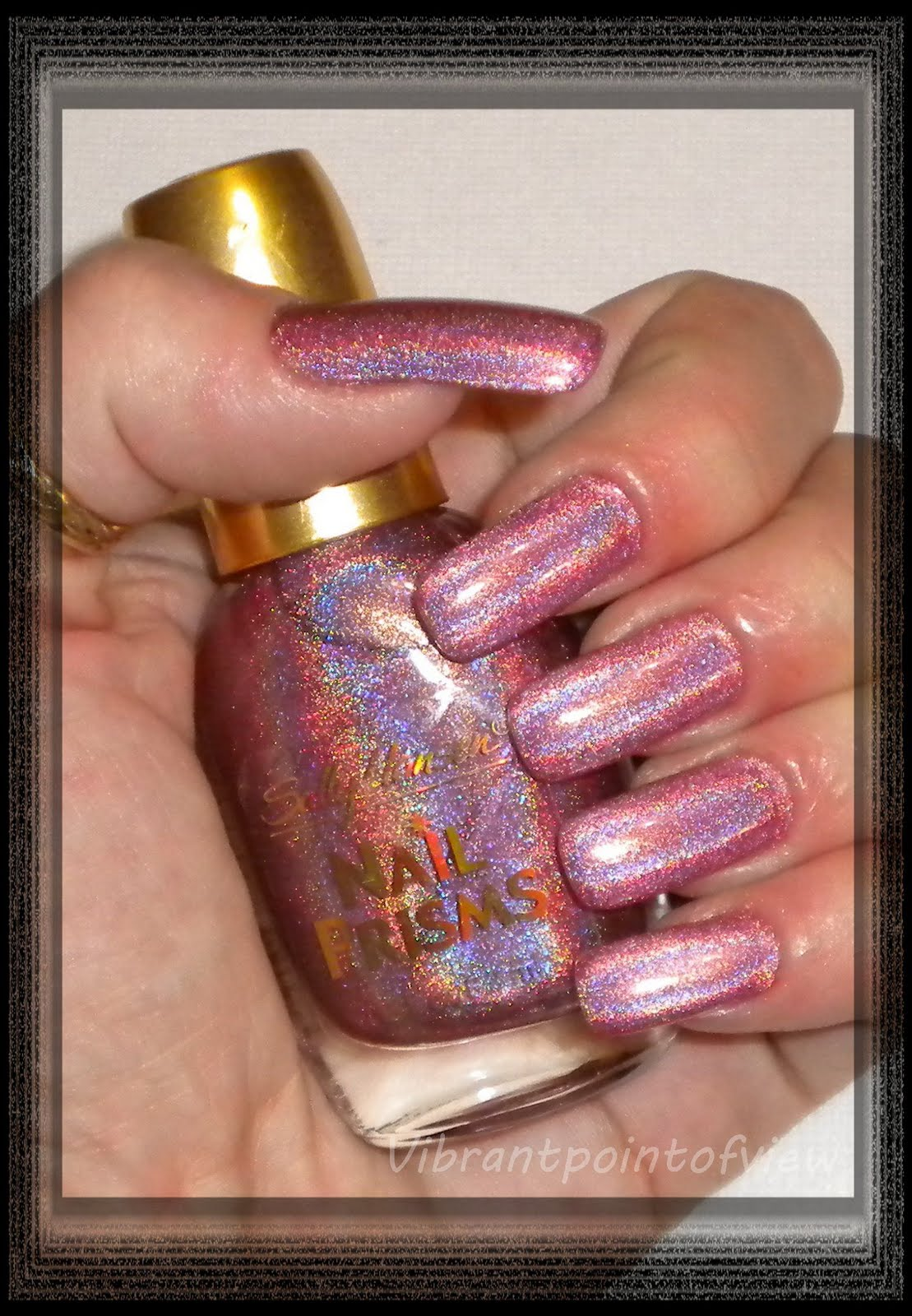 http://2.bp.blogspot.com/_S9X60e_FDVo/TBWSiWSV6wI/AAAAAAAAA5w/YvDBm6N65yQ/s1600/Sally+Hansen+Nail+Prisms+%2302+Pink+Rose+Diamond+Light+Version+-+With+Bottle.jpg