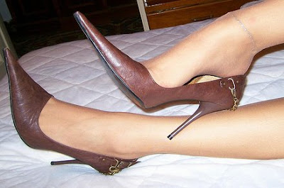 Brown pointy pumps