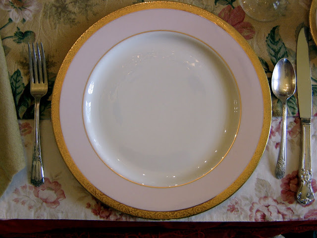Mary Kay gold-rimmed pink and white dinner plates