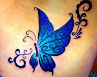 blue butterfly tattoo on breast girl