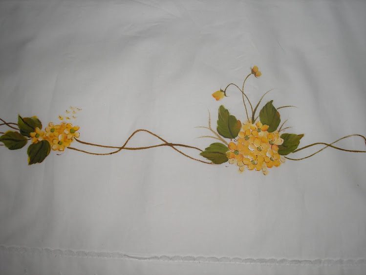 Lençois com flores amarelas