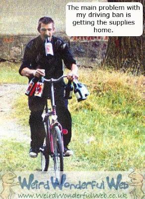 IMAGE: Man on bike carrying 6 bottles of wine