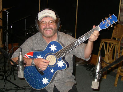 IMAGE: Kevin Bloody Wilson with guitar