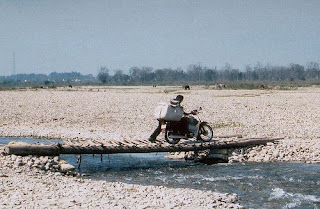 motorcycle on wooden bridge