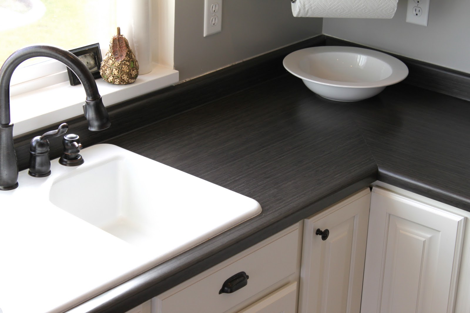Reasonable Countertop Options : We had the builders build a drywall soffit above all the cabinetry, we ...