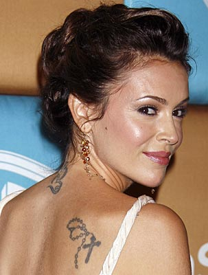 Nicole Richie has a rosary beads tattoo