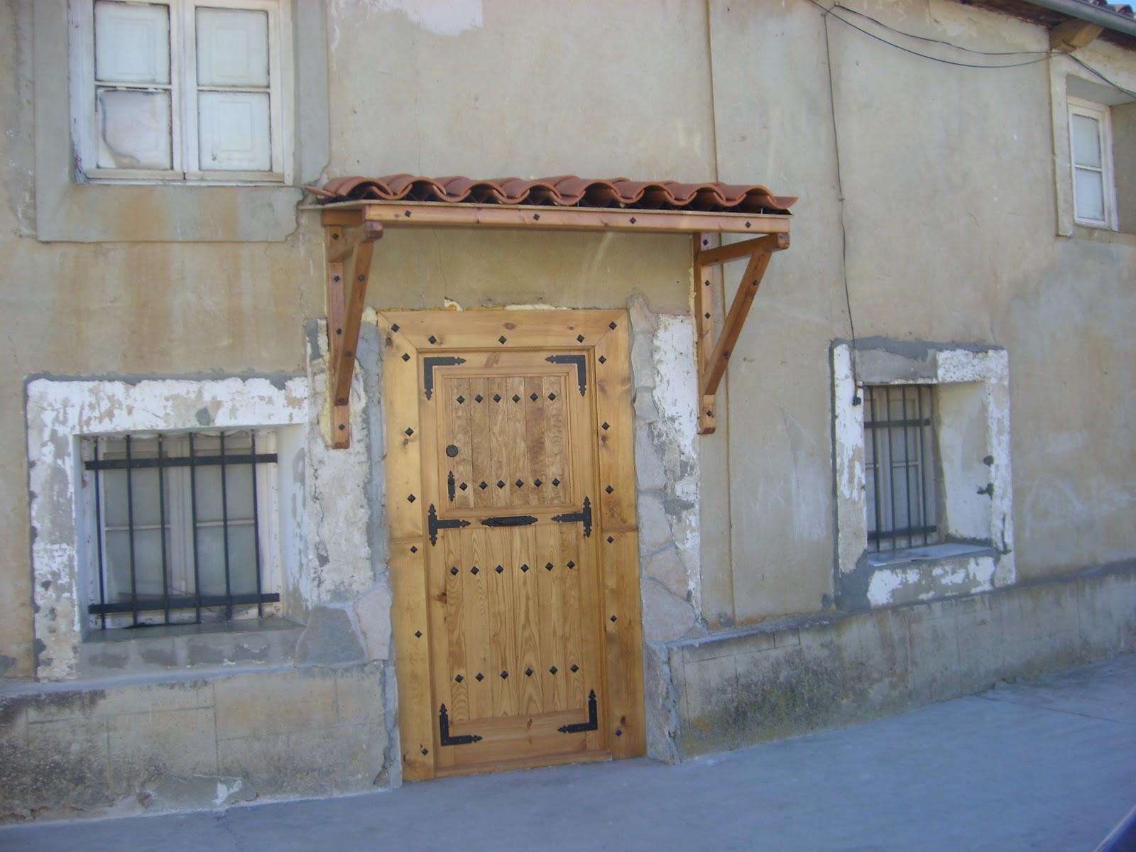 Modifica tu casa tejado sobre puerta de entrada - Tejadillo para puerta ...