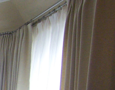 Often, the rod for the sheers is hung below the rod for the drapes.