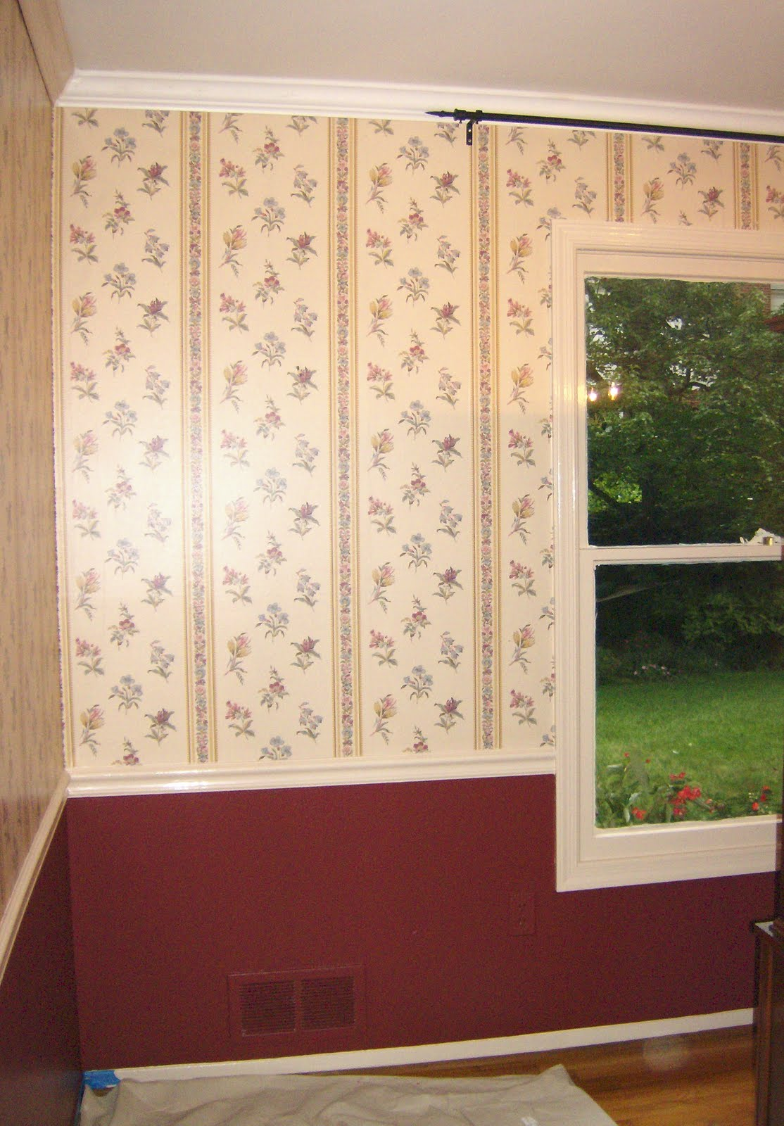I painted the wall below the chair rail a deep red (Ralph Lauren's Nobleman