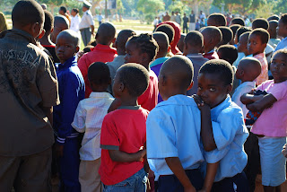 A shy schoolboy in Maputo, Mozambique. Photo by Aquarius Gilmer