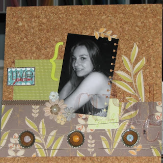 Scrapbook layout on a cork background for a blog hop challenge. The layout is using earthy tones, clear Heidi Swapp alphabet and handmade pop cap embelishments.