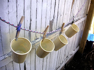 yogurt containers hanging to dry