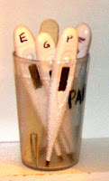 cup of many individual thermometers, with each family member's initial