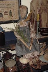 Primitive Prairie doll w/folkart bird
