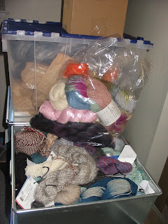 In the bag: handpainted rayon silk; very fine alpaca.  In the box below: all of my handspun yarns