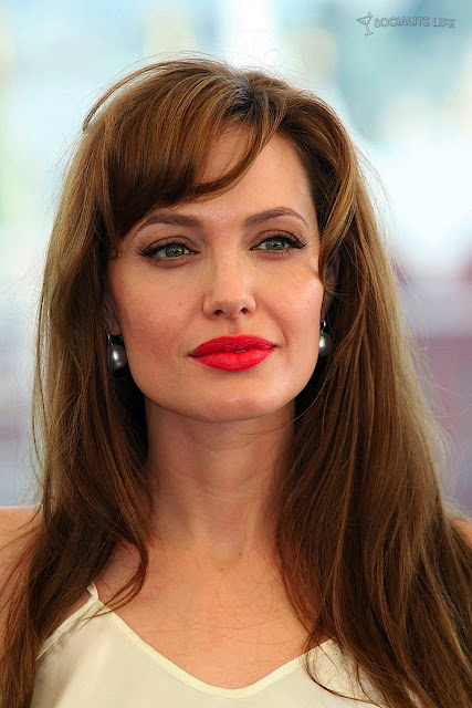 Angelina Jolie Red Hair. Angelina Jolie's signature look is usually about heavier eye makeup and nude