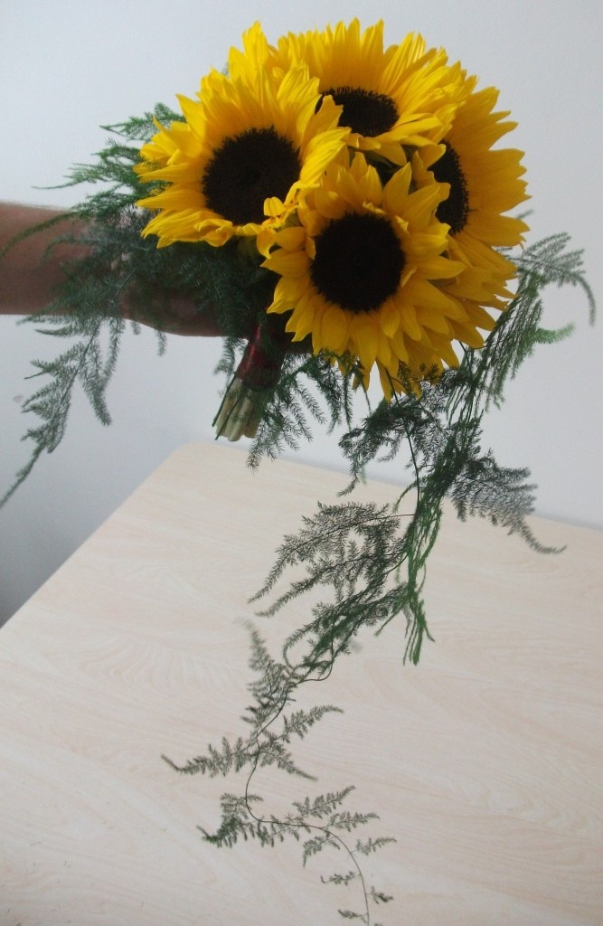 The finished bridal bouquet of sun flowers can be made the day prior to your