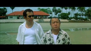 Anthony Wong et Eric Tsang dans Infernal Affairs 2