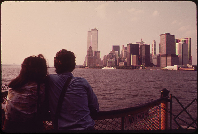 The U.S. National Archives - On the Staten Island Ferry - Looking Back Toward the Skyline of Lower Manhattan - To the Left of the Cluster of Buldings Are the Towers of the World Trade Center 05-1973