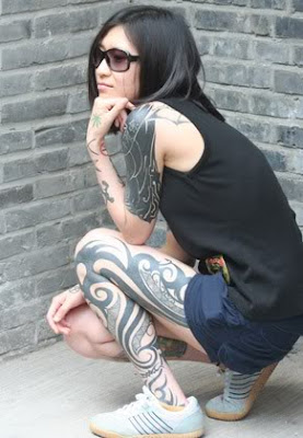 Beautiful Japanese girl with a tattoo on his arm