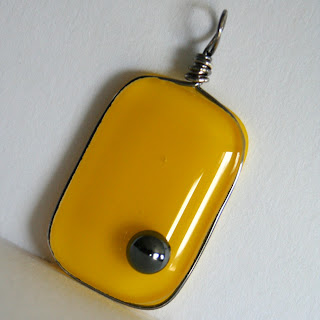 sterling silver wire-wrapped fused glass pendant